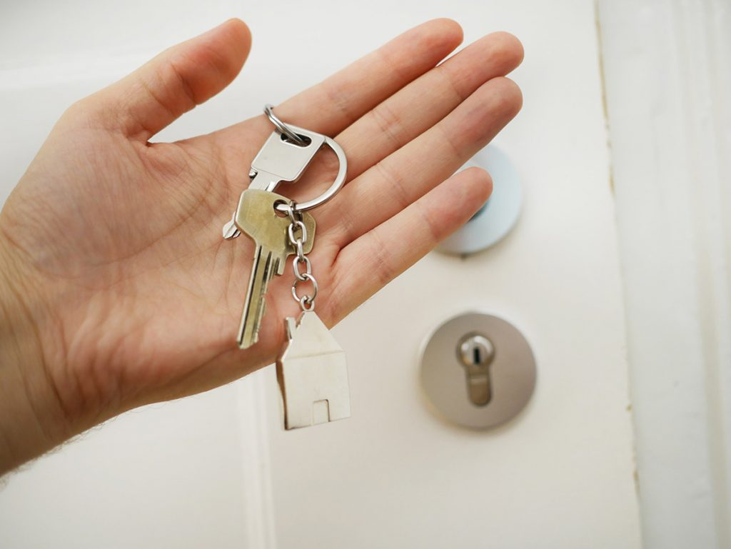 person with house keys to a new home
